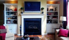 fireplace with built in bookshelves