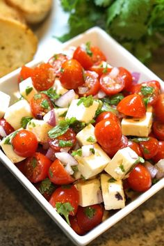 I am not exaggerating that I make this tomato feta salad dozens of times each summer! It is SO good that people ask for the recipe every time I make it!
