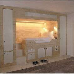 Nook bed with stairs, storage cubbies, and lighting.