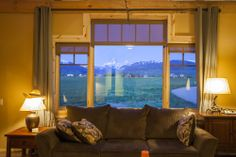 Breathtaking view from this barn home living room!  www.sandcreekpostandbeam.com