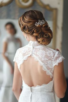 romantic side bridal updo wedding hairstyle with curly details