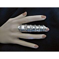 I love these long finger rings