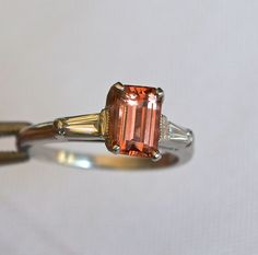 The Imperial Topaz is of choice color and clarity. The color is a wonderful peach hue, and is a rectangular step cut stone. The topaz measures Imperial Topaz, Creative Colour, London Blue, Topaz Ring, Hue, Birthstones, Clarity, Cufflinks, Peach