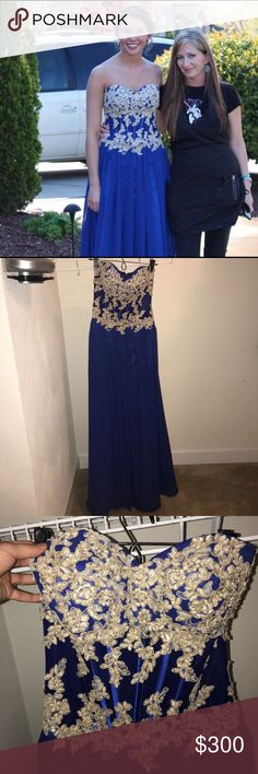 Prom/Ring Dance formal designer gown Royal blue , floor length gown , only been worn once , gold and champagne colored flower accents & beading , semi-sheer corset , zips up with full functioning hook, not too busty, very comfortable!! Faviana Dresses Prom