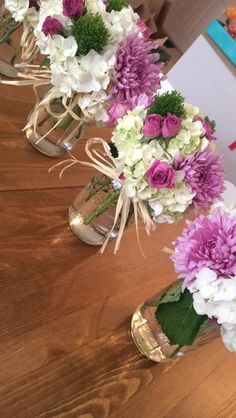 Engagement Party center pieces I made. They are perfect for an outside event or spring. I used big mason jars, hydrangeas, mums disbud, trachelium and rose sprays. They came out beautiful. Perfect DIY bridal shower, rehearsal dinner, flower arraignments. I used raffia to make bows around the mason jars. The colors looked amazing together: white, green, pink and light purple, lilac.