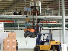 Someone had dominoes made of dominoes. Here is a forklift lifting a forklift.
