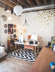 Home office with exposed beams, polkadots and chevron patterns, and lanterns. #HomeOffice #WeWork