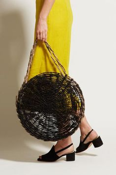 Channel vacation vibes- even when you're not. Hand woven circular market tote that fits perfectly under your shoulder. Black and natural braided strap. Details