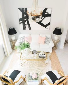 "7,943 Likes, 41 Comments - #LTKhome (@liketoknow.it.home) on Instagram: ""Abstract prints, glam chandelier and pop of pastel pink, chic up your sitting room a la…"""