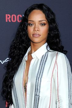 We chart Rihanna's hairstyles and make-up through the years. See all Rihanna's hair styles at GLAMOUR.com