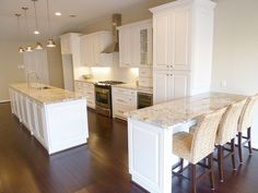 """Love """"White Springs"""" granite with off white cabinets and seagrass bar stools (but I would like them dark brown)."""