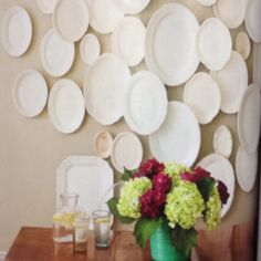 From Flea Market Style.   White plates/platters on wall are perfect decor for a kitchen or dining room.