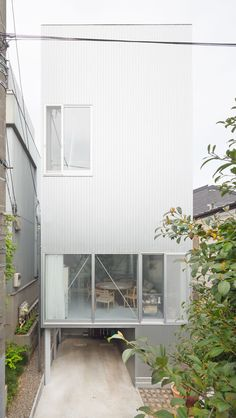 Tsuchihashi House is a minimalist home located in Tokyo, Japan, and designed by Kazuyo Sejima. The residence sits atop a small 775 sqf site, and has a transparent lower level to allow an abundance of natural light to enter the space. Each level is separated by use: the living space in the basement, the kitchen and dining room on the ground floor, and the bedrooms on the upper floors. (7)