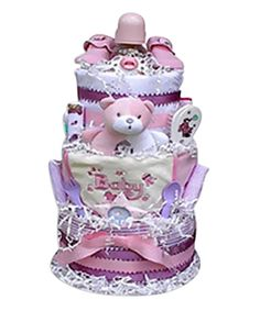 This magnificent 3 tiered diaper cake creation is sure to impress all who see it. Present one as a generous baby shower gift (or group gift) or use it as a creative shower centerpiece. Every item in t