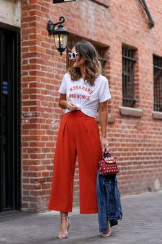 red jumpsuit paired with graphic tee