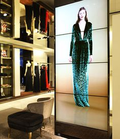 Five columns of super high resolution displays show images of their fashion shows in their retail stores. Interactive Display, Interactive Design, Digital Retail, Retail Technology, Retail Experience, Video Wall, Digital Signage, Retail Design, Visual Merchandising