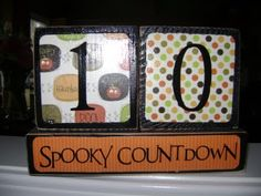 SUPER SATURDAY CRAFT KITS: Wooden block countdown kits. Would be a good way to use up my scrapbook paper scraps