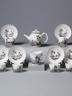 A Chelsea Porcelain Tea service  Painted with Italianate rural and other bucolic scenes.  Circa 1755