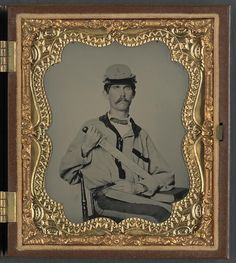 [Soldier in Confederate uniform and Co. D, 3rd North Carolina Volunteers Regiment hat with Bowie knife and sheath with initials J.L.W., probably for Private John L. Wood of Co. D, 3rd North Carolina Infantry Regiment]