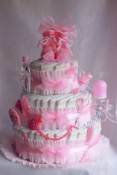 perfect for a baby shower cake made out of diapers & other baby necessities