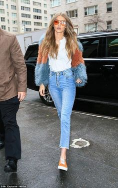 Gigi Hadid, 21, looked fierce in a blue and orange striped fur coat as she was spotted out in New York City for a photo shoot on Wednesday