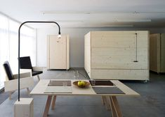 Wooden boxes on wheels fold open to reveal beds inside this minimal apartment in Bolzano, Italy, by Harry Thaler Studio