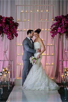 Esta instalación única vela grita boda moderna.Crédito de la imagen: Melange Motley en Estilo Dio a conocer a través de Lover.ly
