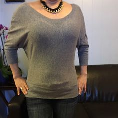American Eagle top Gray top with a 3/4 sleeves. In good used condition. American Eagle Outfitters Tops Blouses