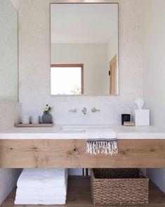 Bathroom design with wood vanity and white marble backsplash | Simo Design.
