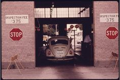 Car entering the safety lane at an auto emission inspection station in downtown Cincinnati, Ohio