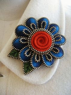 felt and zipper project flower broach .... coiled rose center ... beautiful ...