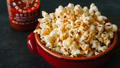 Spicy Sriracha Popcorn 4-6 Servings 3 Tbs canola oil 1/2 cup popcorn kernels 2-3 Tbs butter 1-2 ts sriracha 1-2 tsp kosher salt, to taste Coat the bottom of a large pot (or whirley pop) with canola oil, pour in the kernels & cover, Place on med high heat. When you hear the first kernels pop, begin to shake (or crank the whirley pop handle) until all the corn is popped & transfer to a large bowl Melt the butter & mix in sriracha. Drizzle on popcorn & toss, salt to taste
