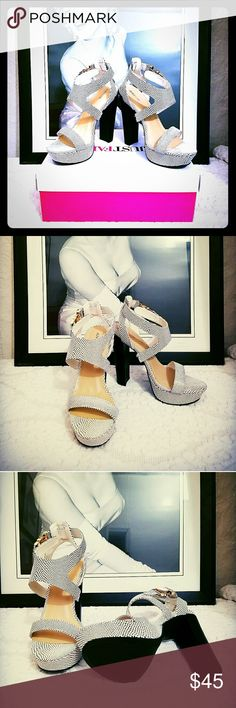Snakeskin platform heel sandals Black and white Snakeskin platform heel sandals..new in box!!! Glamour magazine style watch edition...just fab JustFab Shoes Heels