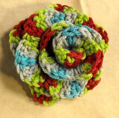 Crocheted flower turned pin.  My version here.  Pattern is good & found here:  http://www.pompomemporium.com/content/crocheted-flowers-roses  #crochet #DIY