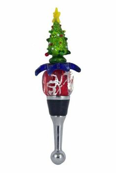 """Christmas Tree Bottle Stopper in Art Glass by LS Arts. $4.99. This bottle stopper is constructed of highly polished stainless steel with a large rubber seal to accommodate different sized bottles. Artistic glass wine and bottle stopper. Dimensions:4 1/2""""H x 2""""W x 1"""". Beautifully designed, this wine or bottle stopper is decorated with a colorful Christmas Tree on a present. Artistic glass wine and bottle stopper. This bottle stopper is constructed of highly polished stainless ..."""