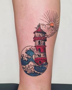 great wave and lighthouse tattoo