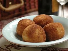 arancini, a recipe courtesy of david rocco - Rice balls stuffed with Mozzarella cheese - would be good to serve with marinara on the side.