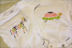 Shower craft have a onesie painting station. Guests could choose from various paints and stencils to create a signature onesie that the mom can use for the baby and as decor in the nursery.
