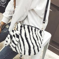 SHARE & Get it FREE | Furry Tassels Zebra-Stripe Faux Fur Crossbody BagFor Fashion Lovers only:80,000+ Items·FREE SHIPPING Join Dresslily: Get YOUR $50 NOW!