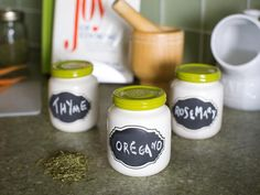 A coat of white paint gives baby food jars a vintage Bakelite look; chalk-friendly labels make them identifiable and the green tops add a jolt of color.