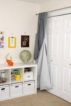 Photography Backdrop DIY.  A large piece of fabric hung by a rod above a closet can easily be tucked away and pulled out for use in a matter of seconds.