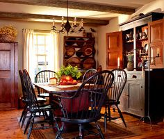 A reproduction double-cone wire chandelier complements a farmhouse dining room furnished with a mix of antiques and reproductions. Primitive Homes, Country Decor, Colonial Dining Room, Primitive Dining Rooms, Farmhouse Dining, Country Dining Rooms, Colonial Decor, Home Decor, Colonial Kitchen