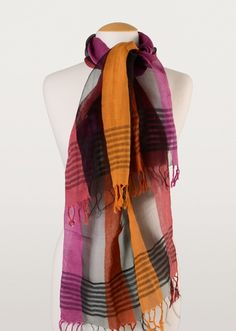 When you need a splash of colour, reach for this cotton silk blend scarf. Strips of purple, gold, orange and burgundy give you everything you need to keep a neck warm and give a boost to the complexion.
