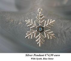 Silver snowflake with blue stone