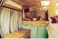 I like the color of the cabinets! Nice van interior!