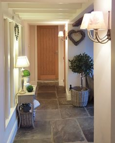 Stone flagged floor, wooden doors and white paintwork Home, Cottage Hallway, House Inspiration, House Styles, Cottage Interiors, New Homes, Barn Interior, House Interior, Ideal Home