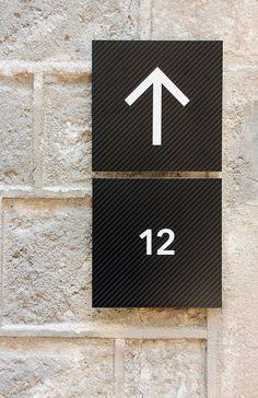 Wayfinding design for the Museu de Cultures del Mon in Barcelona Spain by PFP Signage Display, Signage Design, Environmental Graphic Design, Environmental Graphics, School Signage, Office Signage, Interior Design Tools, Wayfinding Signs, Sign Board Design