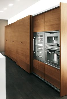 Wood Kitchen slide doors hidden appliances barefootstyling.com