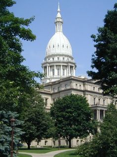 """Photo: Michigan State Capitol, Lansing, Michigan. Credit: Criticalthinker; Wikimedia Commons. Read more on the GenealogyBank blog: """"Michigan Archives: 165 Newspapers for Genealogy Research"""" https://blog.genealogybank.com/michigan-archives-165-newspapers-for-genealogy-research.html"""