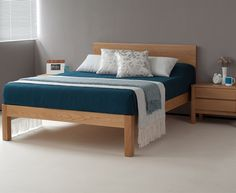 The Tibet bed in solid oak (dressed with bedding exclusive to Natural Bed Company)